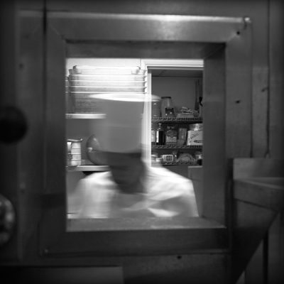 Chef through window in black and white photography